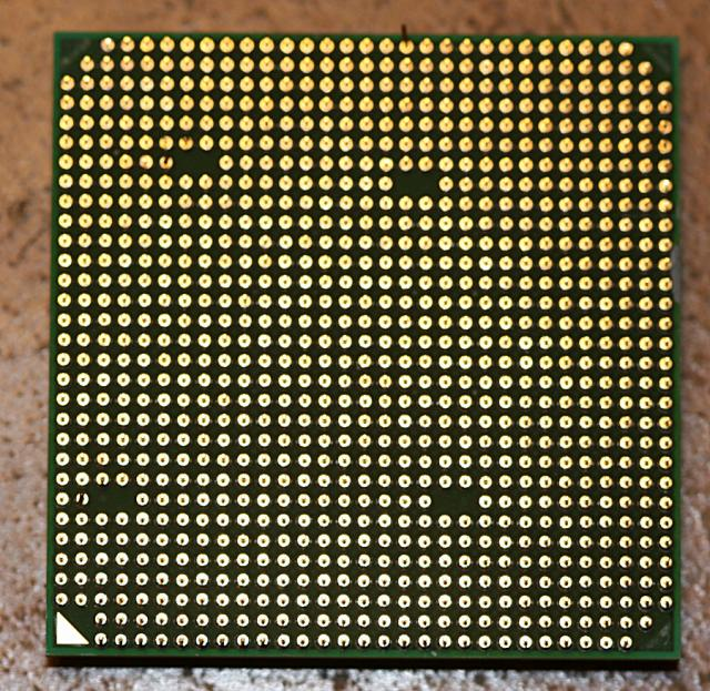 Pins on AMD CPUs have a matching pattern on the motherboard socket, to show the correct orientation