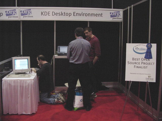 In the KDE booth, developers explaimed their desktop and prayed to the PowerBook god.